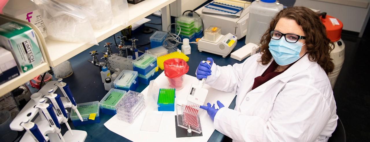 Christina Wicker works in the lab in the Vontz