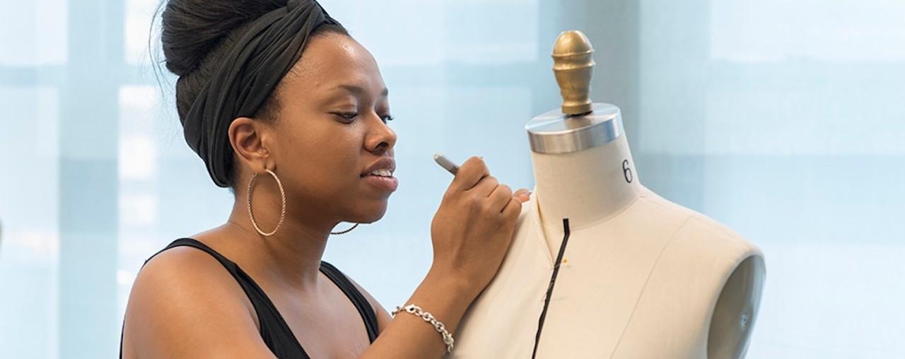 Fashion designer works on a dress form