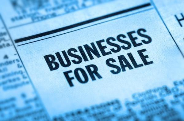 """zoom in on """"business for sale"""" ad in newspaper"""
