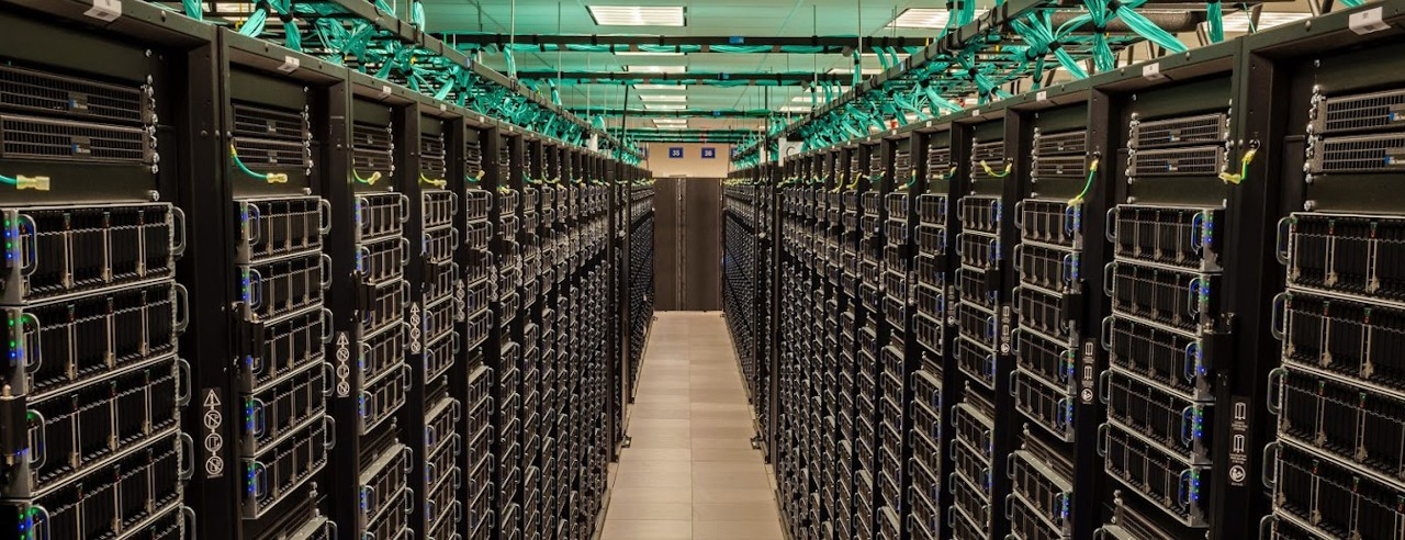 A view between two rows of the Frontera supercomputer's servers at the Texas Advanced Computing Center data center.