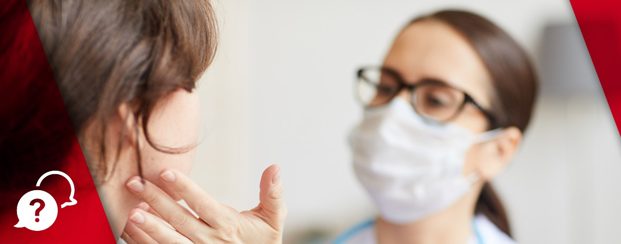 Young woman sitting while nurse practitioner examines her throat