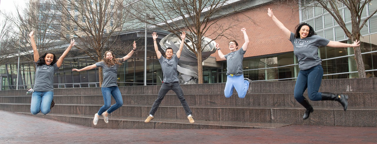 Fourth-year medical students shown outside the College of Medicine: Sarah Smith, Elizabeth Hellmann, Sven Wang, Thomas Daley and Hagar Elgendy.