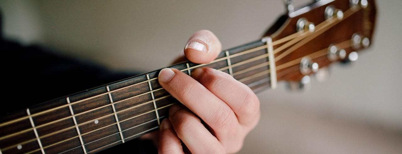A close up of a guitar chord.