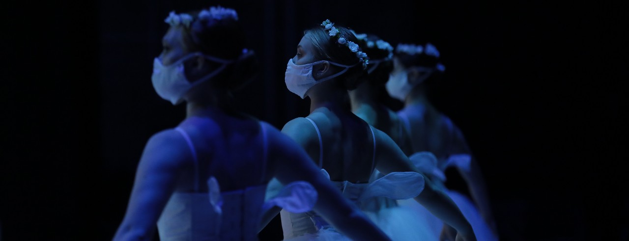 Dancers preparing for the Travelogue performance