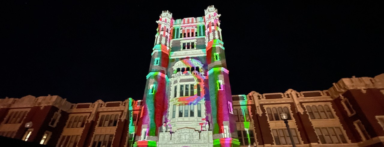 A colorful light show projected onto a building
