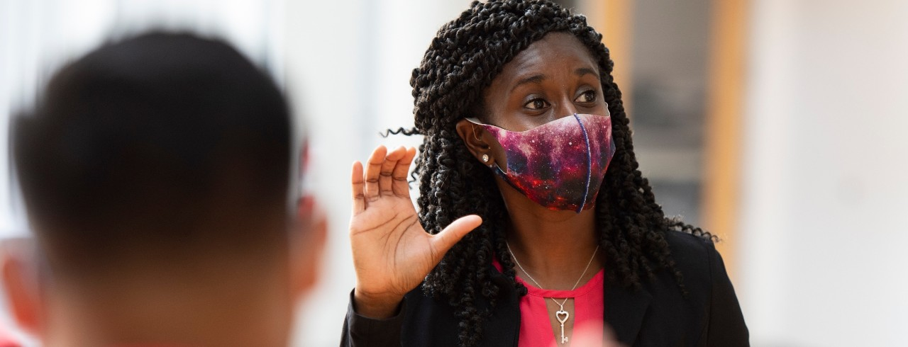 Instructor wearing a mask on campus