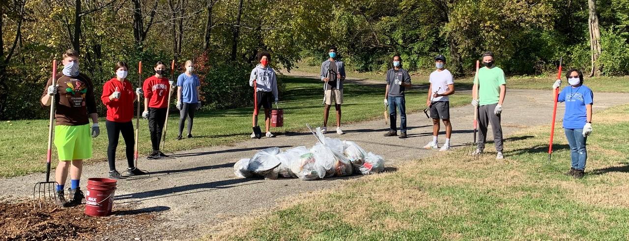 10 masked volunteers clean Coy Field