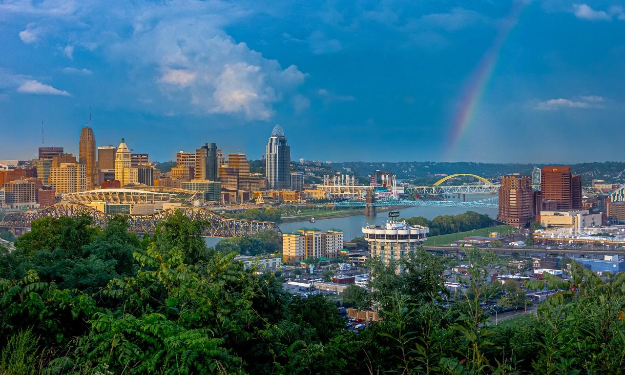 view of Cincinnati skyline with a rainbow