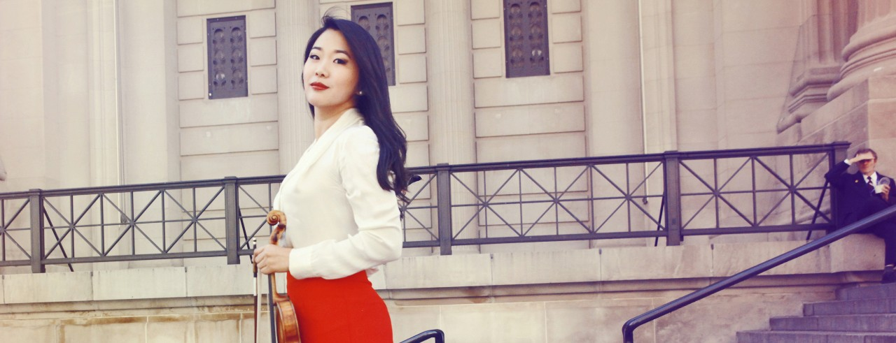 A photograph of new CCM faculty member Kristin Lee holding her violin. Photo/Sophie Zhai