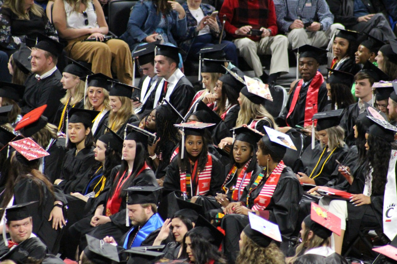 UC students at a commencement ceremony.
