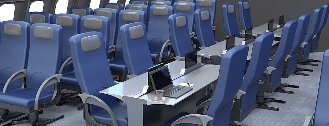 Plane cabin with long table rows