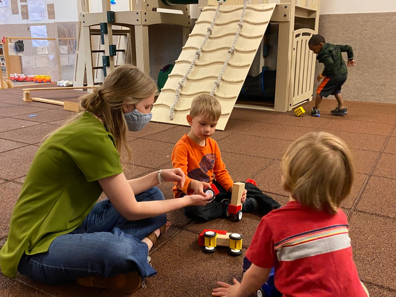 """Hanna Berwanger, CECH '15, '20, works in the Phyllis Goldsmith Levinson Playroom at the Arlitt Center, an indoor gross-motor play space affectionately dubbed the """"muscle room."""""""