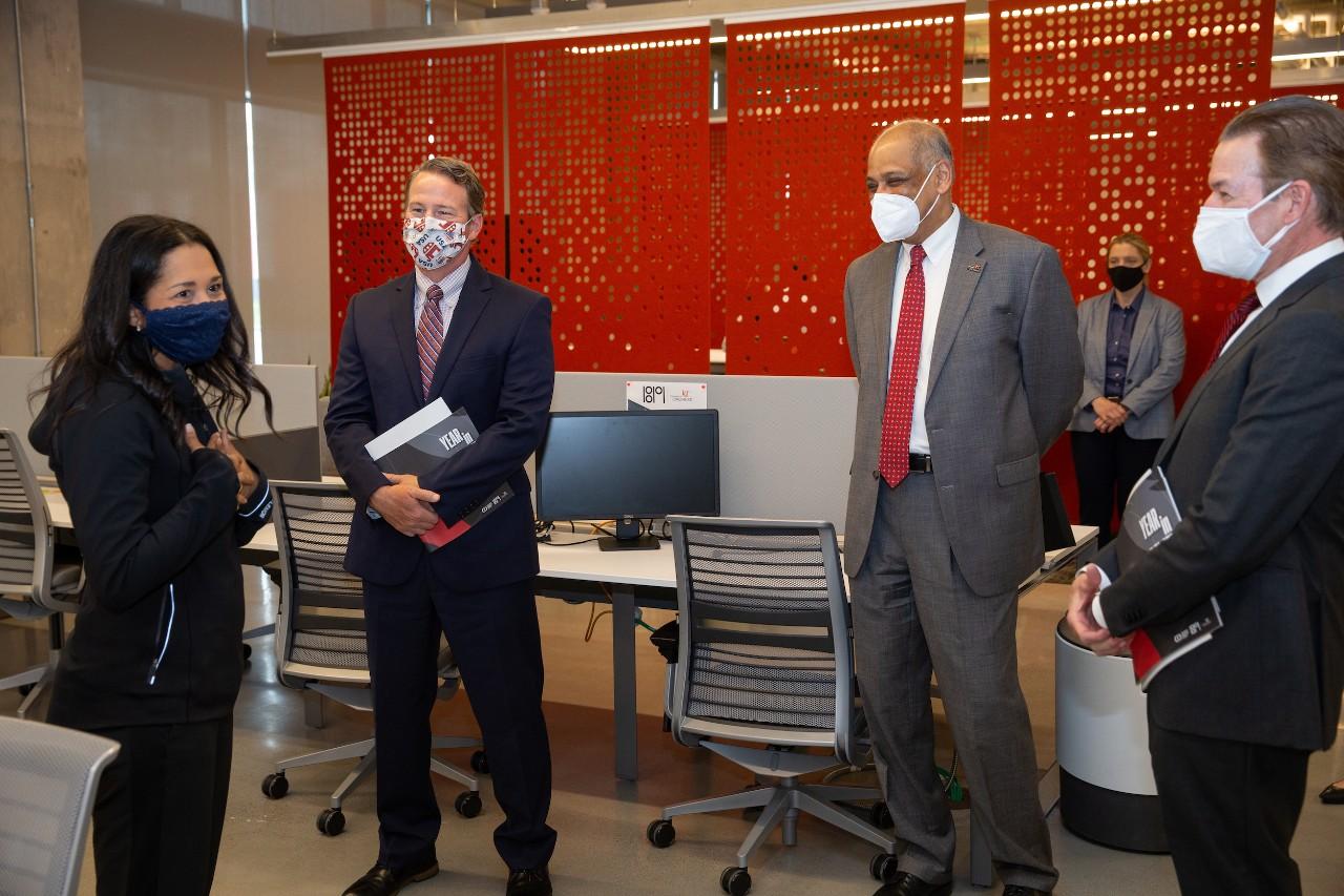 UC President Pinto and David Adams stand inside UC's 1819 Innovation Hub with Candice Matthews Brackeen and Ohio Lt. Gov. Jon Husted.
