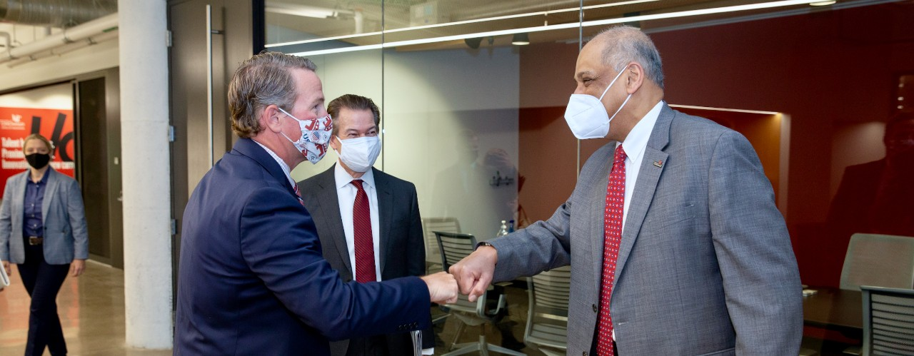 Ohio Lt. Gov. Jon Husted bumps fists with UC President Neville G. Pinto in the 1819 Innovation Hub.