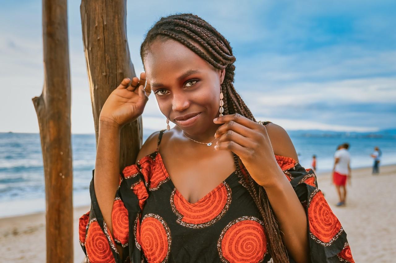 black woman walking along the beach