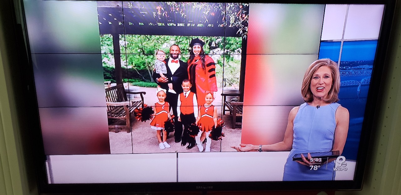 image of WCPO journalist Kristyn Hartman with family of Hagar Elgendy in the background