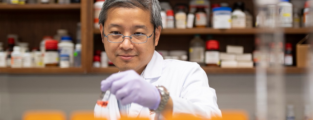 Kevin Li in his lab at the College of Pharmacy