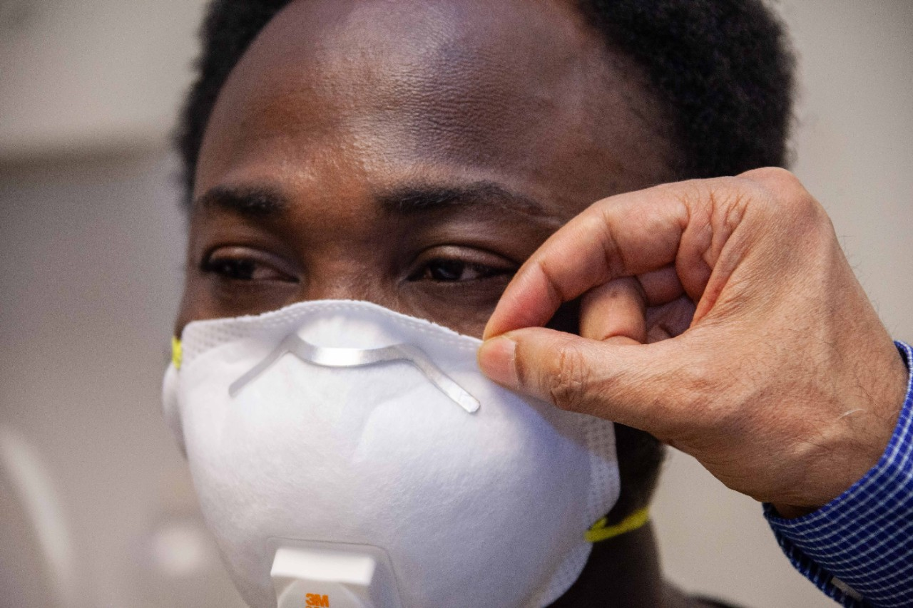 UC College of Engineering and Applied Science grad student Israel Ajiboye wears an N95 face mask.
