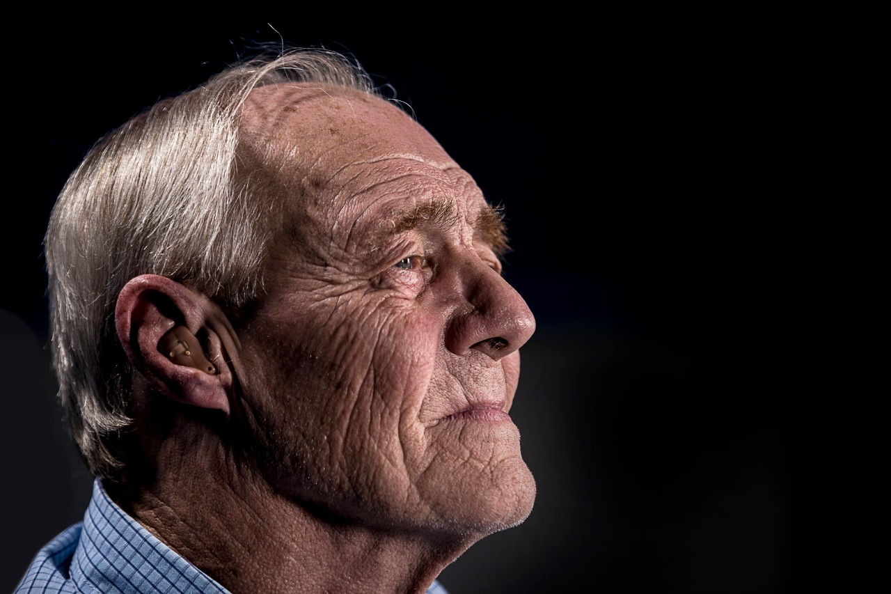 older man with a hearing aid