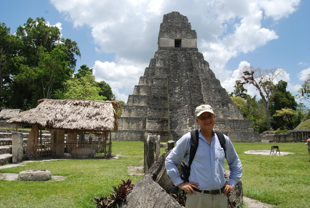 UC biologist David Lentz stands in front of a pyramid at Tikal.