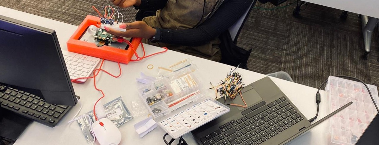 student works on electrical sensors