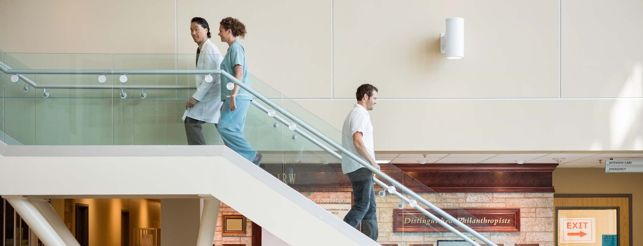 Medical personnel on hospital staircase