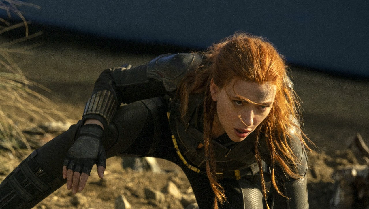 Scarlett Johansson crouches as Black Widow in a still from the movie.