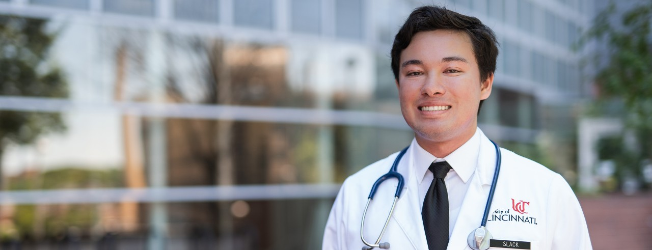 male medical student in white coat