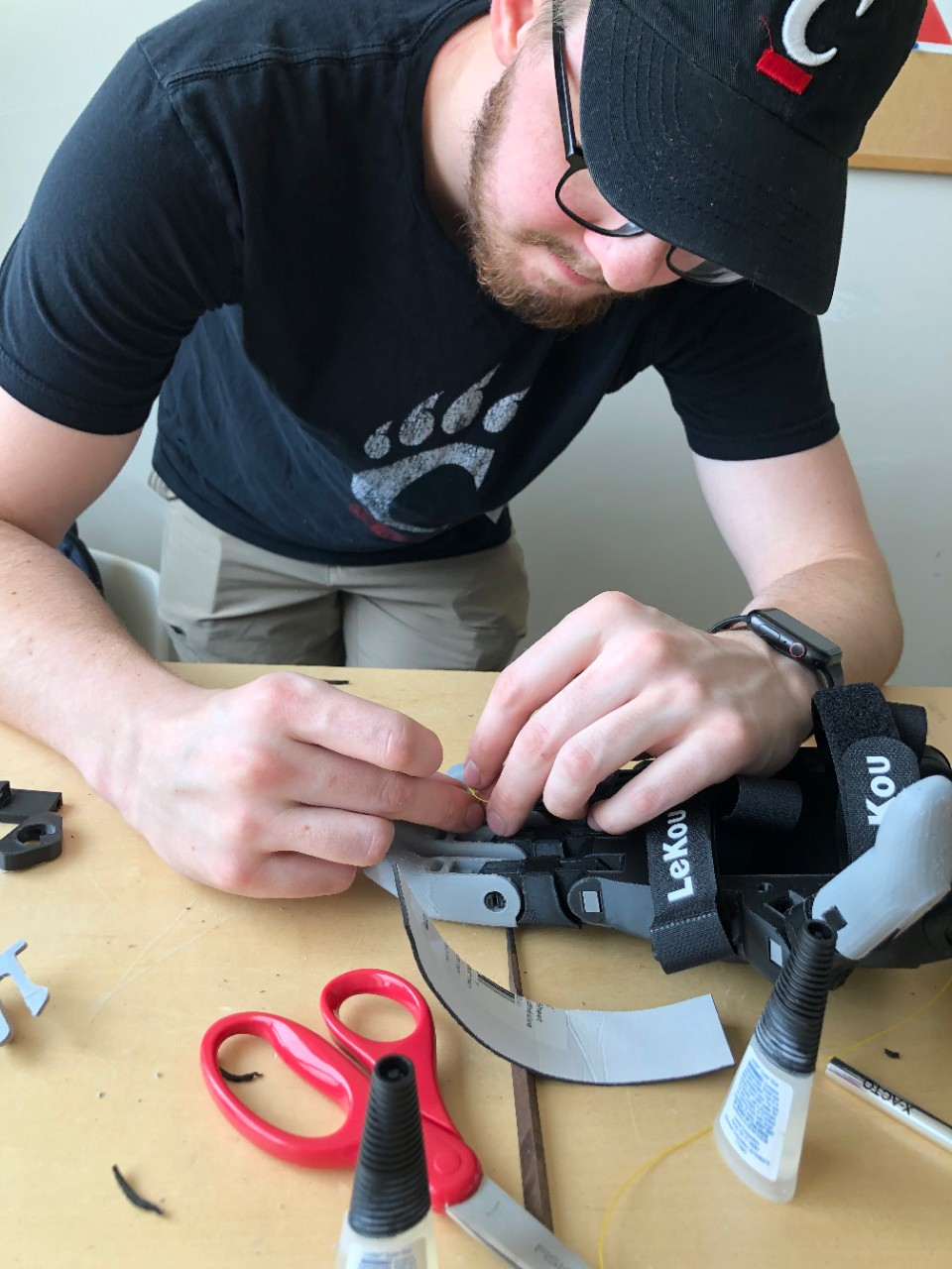 Andrew working on a mechanism