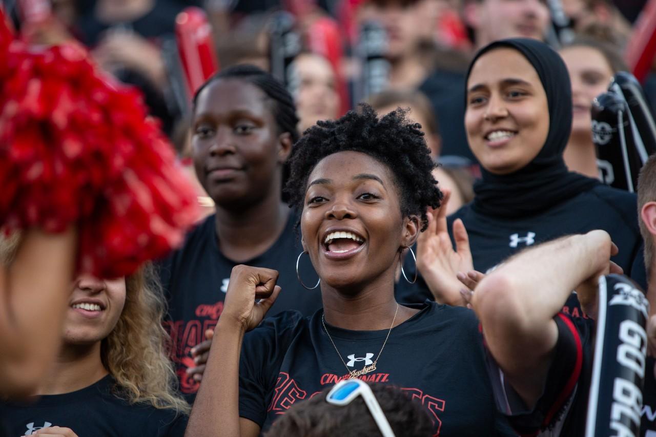 Students cheer at a football game