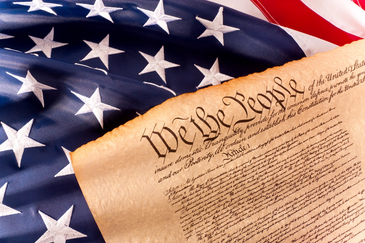 Photo of U.S. flag and U.S. Constitution