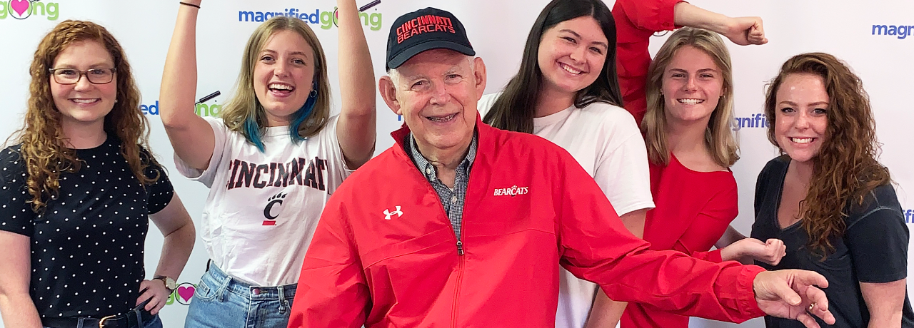 Roger Grein shown with a group of UC students.