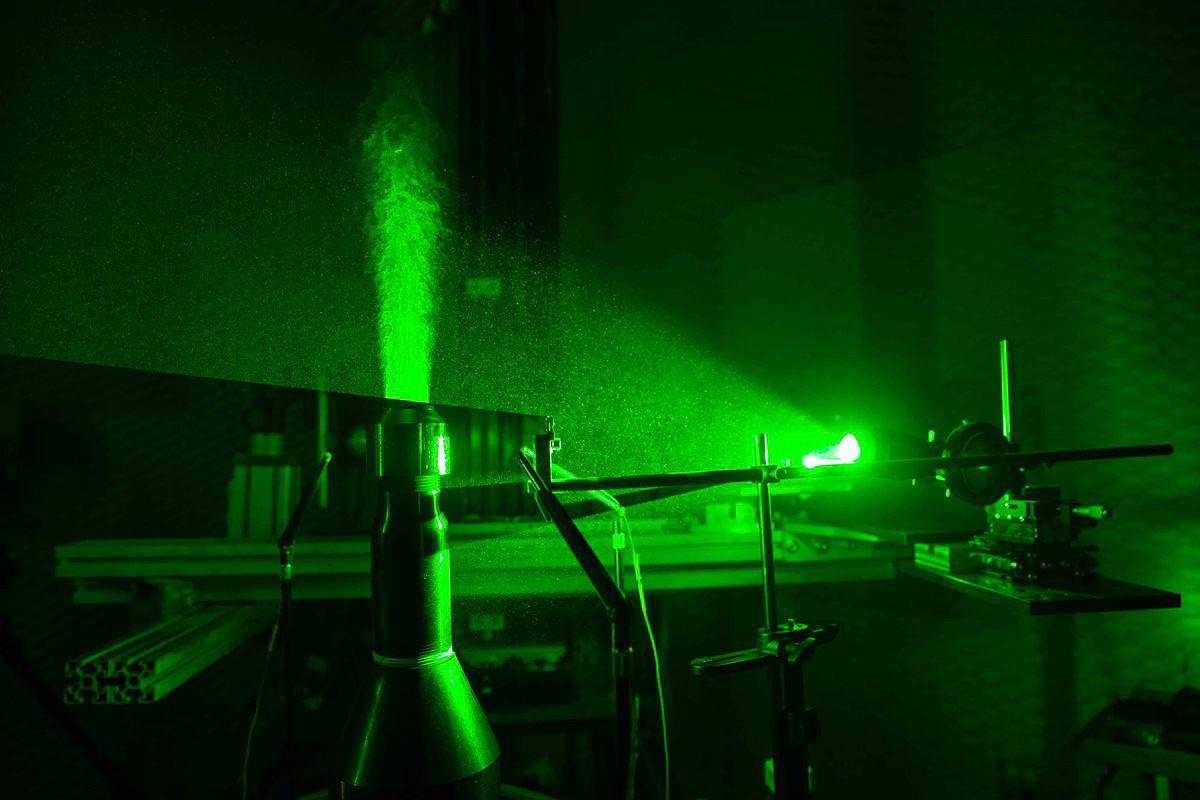 Laser light illuminates a jet engine in UC's aeroacoustics lab.
