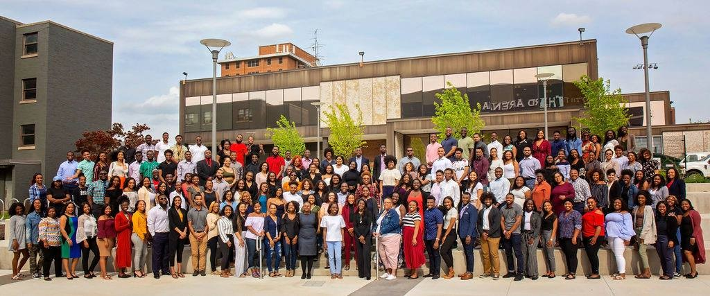 UC community members show their support for the AACRC and pose in front of the structure.