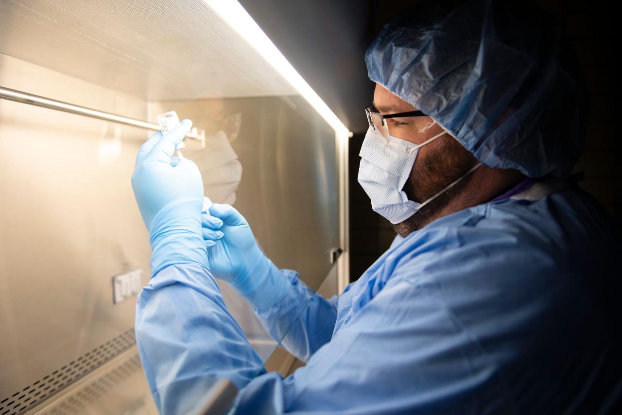 A pharmacist prepares a dose of vaccine