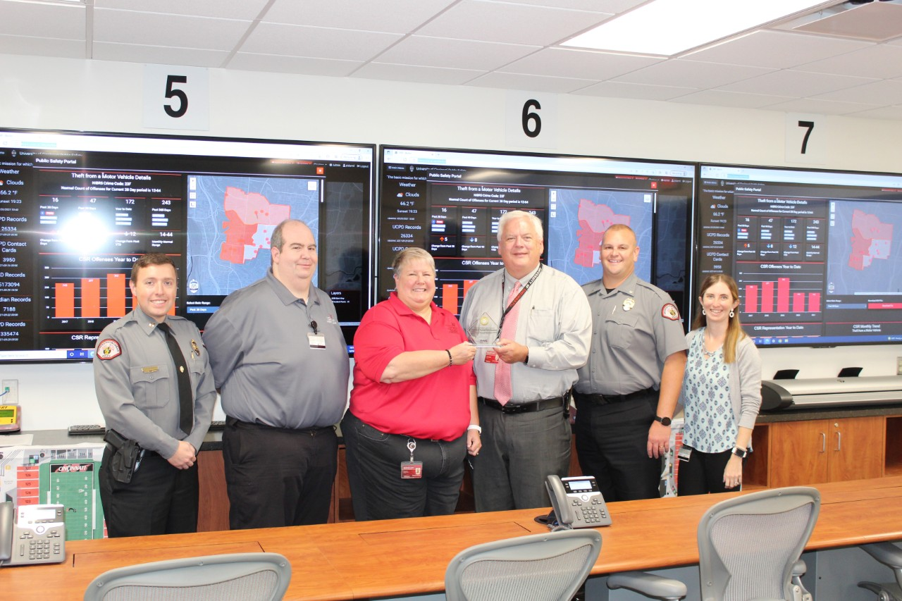 Members of UC Public Safety pose with the SmartSave Award.