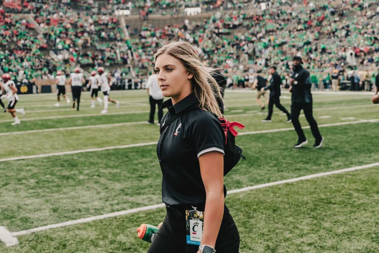 Hannah on the field at the UC vs Notre Dame football game