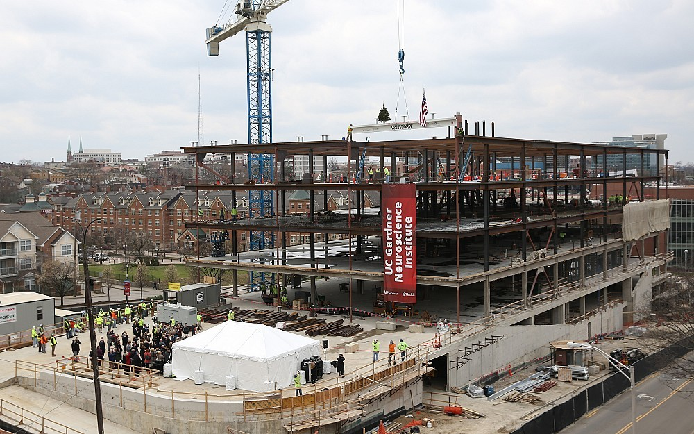 "View of the UC Gardner Neuroscience Institute raising the final beam as part of a ""topping off"" celebration, April 10, 2018."