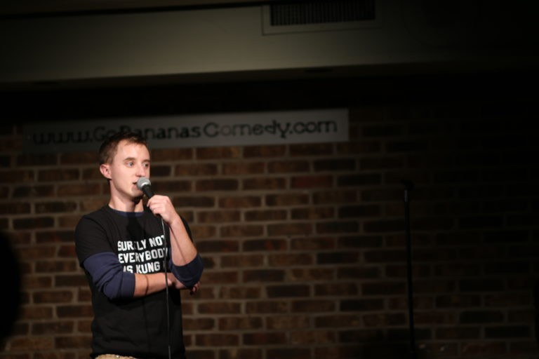 Tanner Hinds performs onstage at Go Bananas, a local comedy club. Hinds says after TMS therapy for his treatment-resistant depression, he was able to return to his interests like performing stand-up.